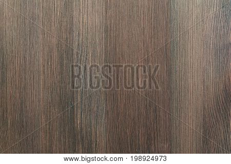 Natural color wooden floor surface. Textured background from mocha wood planks. Vertical grain.