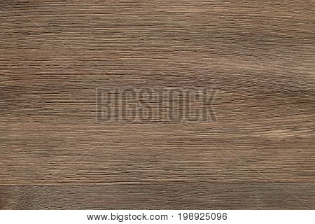 Natural color wooden floor surface. Textured background from woodnut planks. Horizontal grain.