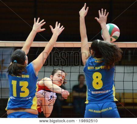 KAPOSVAR, HUNGARY - DECEMBER 12: Gabriella Kondor (13) blocks the ball at the Hungarian NB I. League woman volleyball game Kaposvar vs Eger on December 12, 2010 in Kaposvar, Hungary.