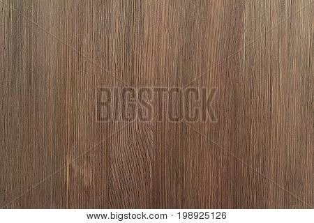 Natural color wooden board surface. Textured background from woodnut planks. Vertical grain.