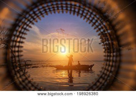 Fisherman of Bangpra Lake in action when fishing Thailand