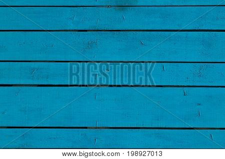 Blue vintage painted wooden panel with horizontal planks.