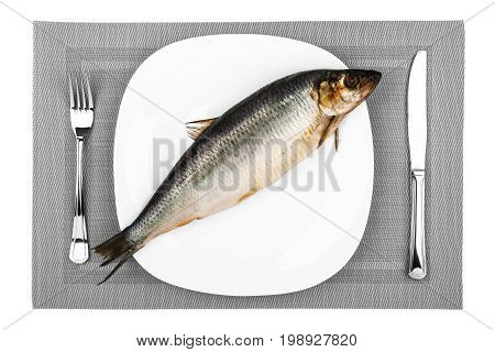 Large raw fish on a white plate close-up top view