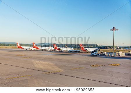 Zurich Switzerland - June 11 2017: Airport Zurich (Flughafen Zurich) - view of airfield with several planes of airline