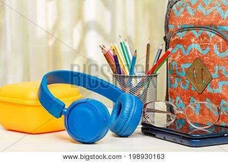 School Backpack With School Supplies. Stand For Pencils With Color Pencils, Sandwich Box, Headphones