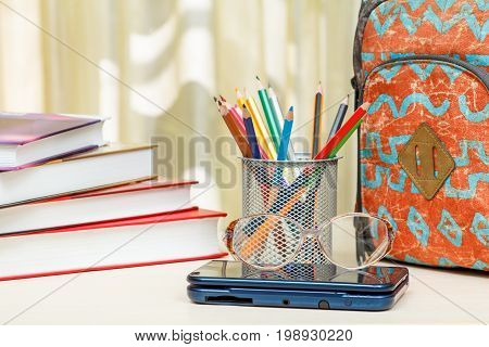 School Backpack With School Supplies. Books, Stand For Pencils With Color Pencils, Glasses And Ebook