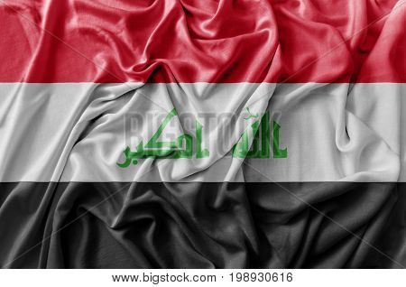 Ruffled national flag waving Iraq flag close