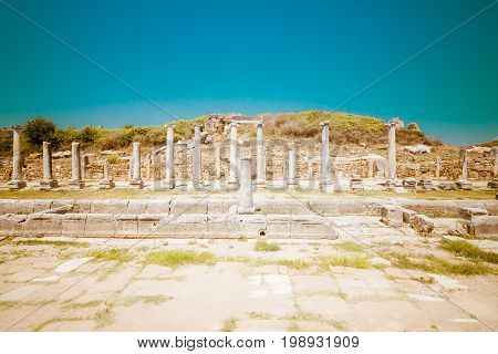 Ancient ruins of Perge. The colonnaded street. Stylized color film. Toning. Turkey