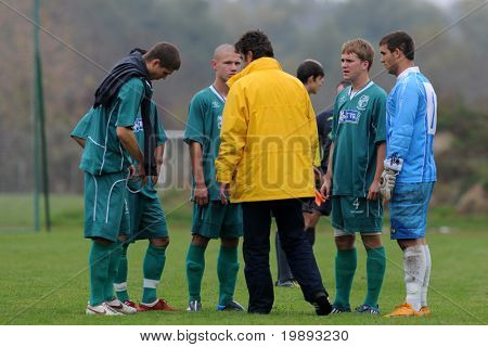 KAPOSVAR, HUNGARY - OCTOBER 16: Kaposvar players listening to the coach before the Hungarian National Championship under 19 game between Kaposvar and Debrecen October 16, 2010 in Kaposvar, Hungary.