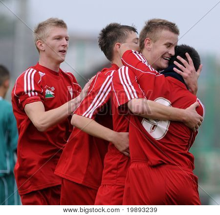 KAPOSVAR, HUNGARY - OCTOBER 16: Debrecen players celebrate a goal at the Hungarian National Championship under 19 game between Kaposvar and Debrecen October 16, 2010 in Kaposvar, Hungary.