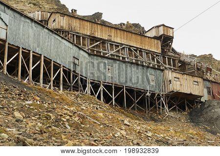 LONGYEARBYEN, NORWAY - SEPTEMBER 01, 2011: Exterior of the abandoned arctic coal mine building in Longyearbyen, Norway.