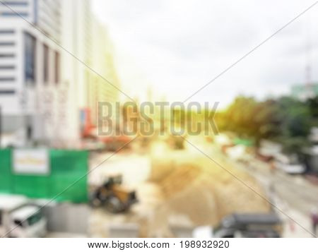Blurred Image Of Construction Workers On Site And Machinery On The Street Building.  Construction Co