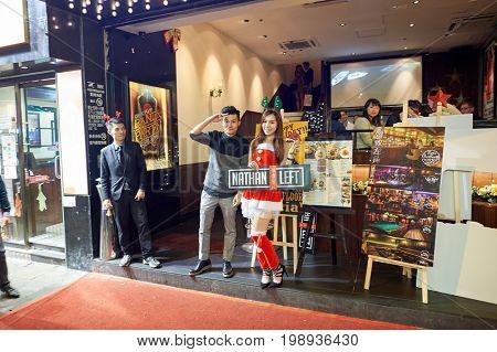 HONG KONG - DECEMBER 25, 2015: people at Christmas night in Kowloon. Kowloon is an area in Hong Kong comprising the Kowloon Peninsula and New Kowloon.