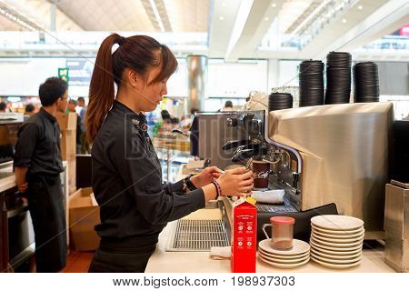 HONG KONG - CIRCA NOVEMBER, 2016: barista prepare coffee at a McCafe in Hong Kong. McCafe is a coffee-house-style food and drink chain, owned by McDonald's.