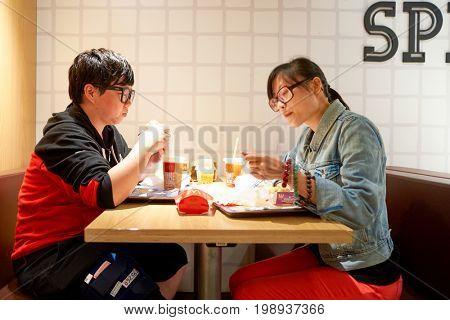 HONG KONG - CIRCA NOVEMBER, 2016: inside a McDonald's restaurant in Hong Kong. McDonald's, or simply McD, is an American hamburger and fast food restaurant chain.