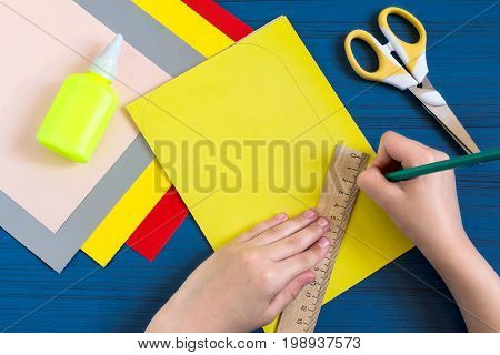 Making greeting card in form of pencil for new school year. Welcome back to school. Children's art project. DIY concept. Step-by-step photo instruction. Step 3. Child draws form of pencil