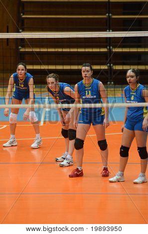 KAPOSVAR, HUNGARY - JANUARY 14: Kaposvar players in action at the Hungarian NB I. League woman volleyball game Kaposvar vs Ujbuda, January 14, 2011 in Kaposvar, Hungary.