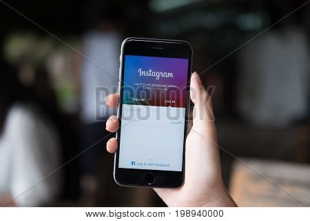 CHIANG MAI THAILAND - JUL 30 2017: A man holds Apple iPhone with Instagram application on the screen. Instagram is a photo-sharing app for smartphones.