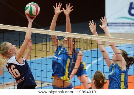KAPOSVAR, HUNGARY - JANUARY 14: Zsofia Harmath (C) blocks the ball at the Hungarian NB I. League woman volleyball game Kaposvar vs Ujbuda, January 14, 2011 in Kaposvar, Hungary.