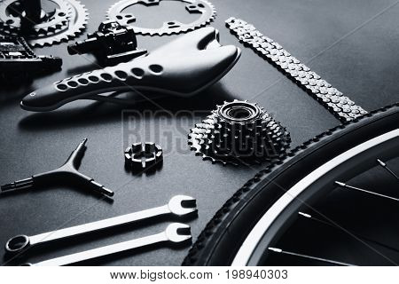 Bicycle parts and repair tools on gray background