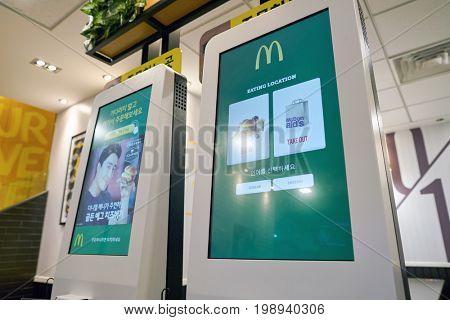 BUSAN, SOUTH KOREA - CIRCA MAY, 2017: ordering kiosk at McDonald's. McDonald's is an American hamburger and fast food restaurant chain.