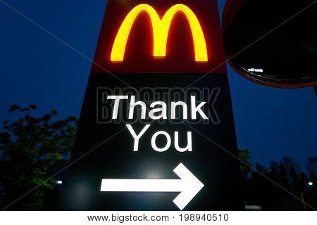 BUSAN, SOUTH KOREA - CIRCA MAY, 2017: close up shot of McDonald's sign. McDonald's is an American hamburger and fast food restaurant chain.