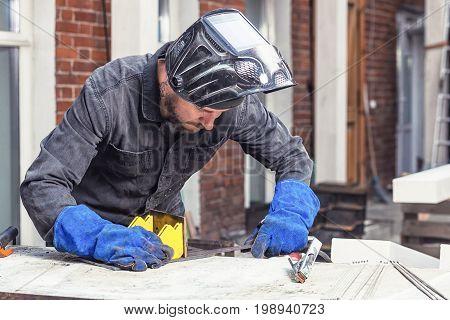 Man Makes A Metal Construction