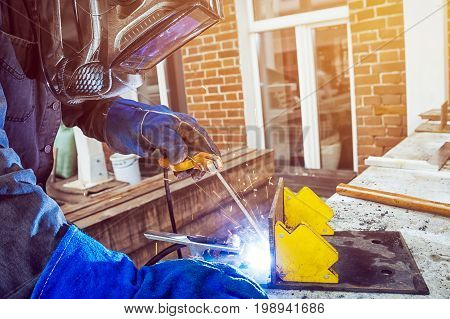 Man Brewing A Metal Welding Machine