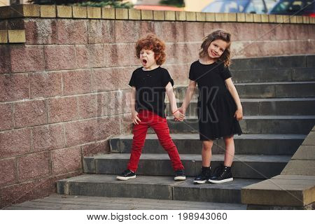 cute boy and girl on the street