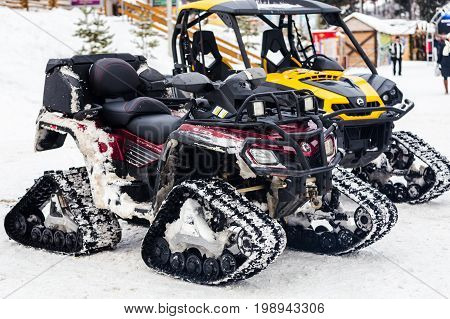 Two Empty Snowmobiles
