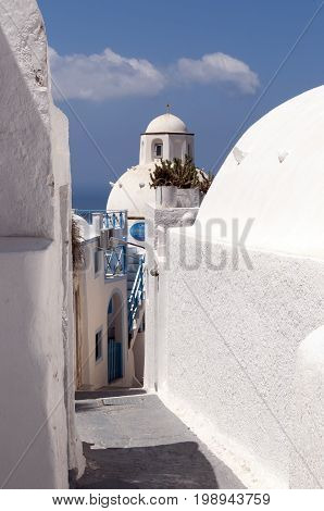 Editorial Santorini, Greece - July 05, 2013: A narrow alleyway on Santorini, a Greek island in the southern Aegean Sea whose two main sources of wealth are agriculture and tourism.