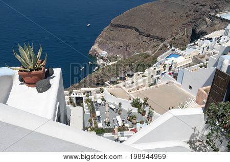 Editorial Santorini, Greece - July 05, 2013: Small boats at Santorini, the wonderful Greek island in the southern Aegean Sea whose two main sources of wealth are agriculture and tourism, known for blue and white buildings.