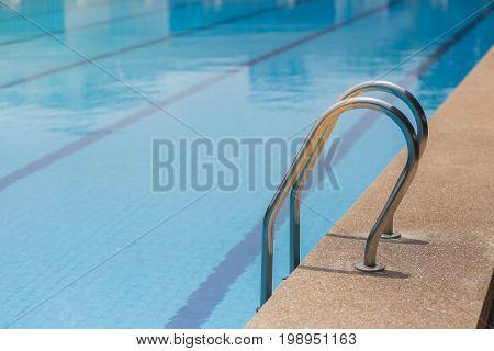 Pool ladder step of a swimming pool.