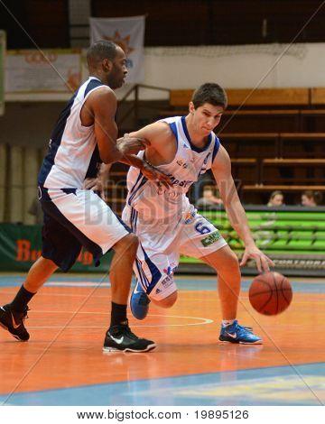 KAPOSVAR, HUNGARY - JANUARY 26: Gergely Kutasi (R) in action at a Hugarian Cup basketball game Kaposvar vs. Szeged January 26, 2011 in Kaposvar, Hungary.