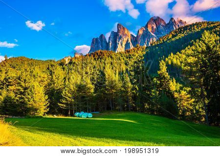 The valley of the Dolomites. Magnificent serrated cliffs illuminate the summer sunset. The concept of eco-tourism in Tirol