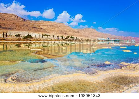 The evaporated salt. Reduced water in the very salty Dead Sea. Dead Sea, Israel. The concept of medical and ecological tourism