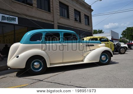 CASSELTON, NORTH DAKOTA, July 27, 2017: The annual Casselton Car Show which occurs the last Thursday of July features classic vehicles such as the restored 1937 four door Chevy