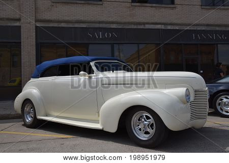 CASSELTON, NORTH DAKOTA, July 27, 2017: The annual Casselton Car Show which occurs the last Thursday of July features classic vehicles such as the restored 1937 two door Chevy convertible