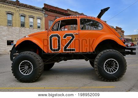 CASSELTON, NORTH DAKOTA, July 27, 2017: The annual Casselton Car Show which occurs the last Thursday of July features classic vehicles such as the restored 1960's Volkswagen Bug in oversized tires.