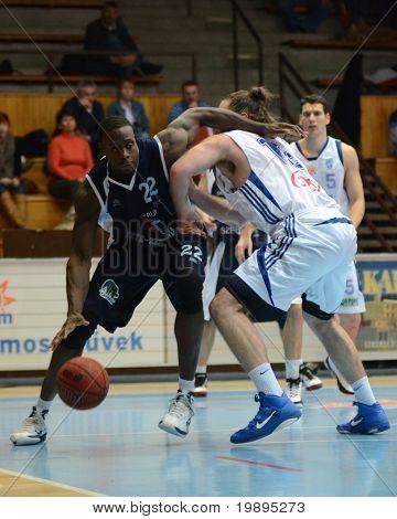 KAPOSVAR, HUNGARY - JANUARY 26: Kurt Cunningham (C) in action at a Hugarian Cup basketball game Kaposvar vs. Szeged January 26, 2011 in Kaposvar, Hungary.