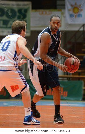 KAPOSVAR, HUNGARY - JANUARY 26: Joshua Wilson (L) in action at a Hugarian Cup basketball game Kaposvar vs. Szeged January 26, 2011 in Kaposvar, Hungary.