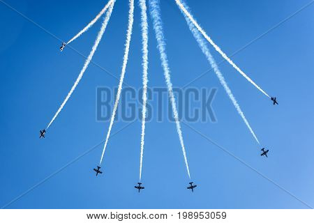 Moscow Region - July 21, 2017: Aerobatic display team from the United Arab Emirates in the blue sky at the International Aviation and Space Salon (MAKS) in Zhukovsky.