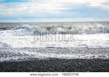 Black sand beach, Reynisfjara shore near the village Vik, atlantic ocean, Iceland.