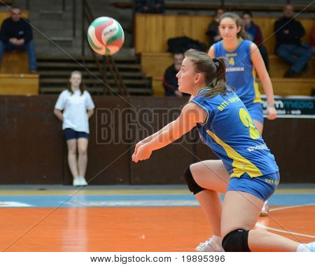 KAPOSVAR, HUNGARY - FEBRUARY 4: Zsanett Pinter (2) receives the ball at the Hungarian NB I. League woman volleyball game Kaposvar vs Szolnok, February 4, 2011 in Kaposvar, Hungary.