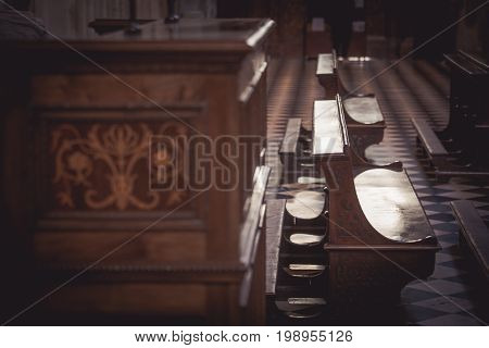Empty wooden benches in the church Italy