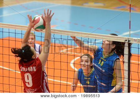KAPOSVAR, HUNGARY - FEBRUARY 4: Szandra Szombathelyi (R) strikes the ball at the Hungarian NB I. League woman volleyball game Kaposvar vs Szolnok, February 4, 2011 in Kaposvar, Hungary.