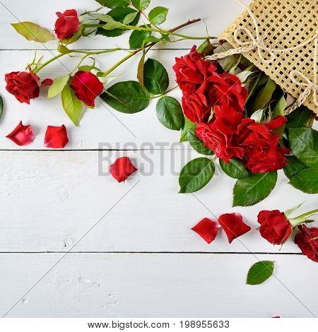Flowers composition. Red roses on a white wooden background. Flat lay top view