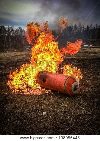 Burning balloon with gas in the field Fire