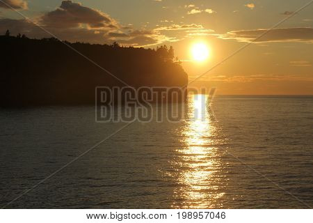 Sunset over the cliffs of Pictured Rocks National Lakeshore.   Pictured Rocks National Lakeshore, Upper Peninsula of Michigan