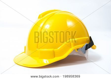 Yellow safety helmet on white background safety industry